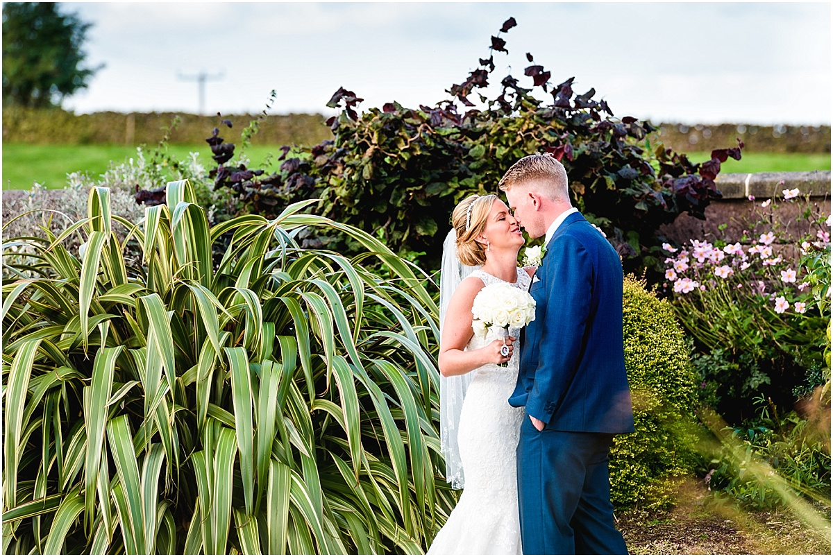 bride and groom in heaton house farm water gardens