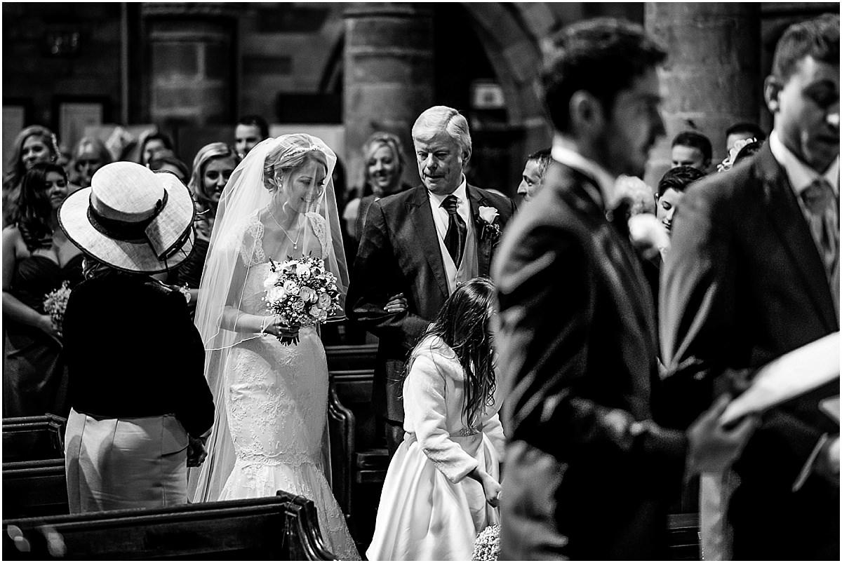bride walking down isle with dad