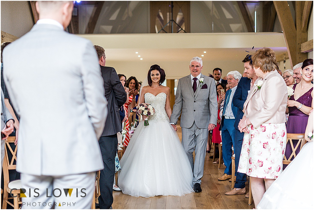 bride and father walk down the isle