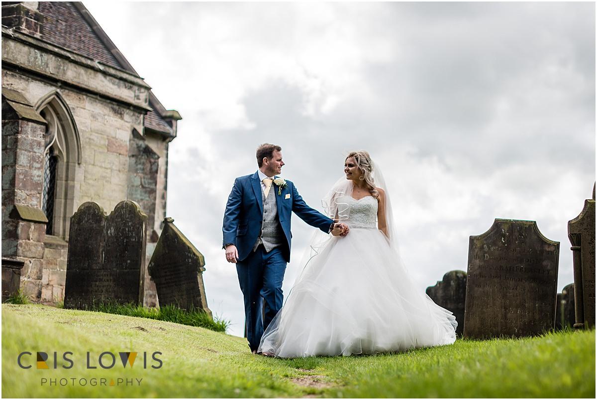 bride and groom at sandon church