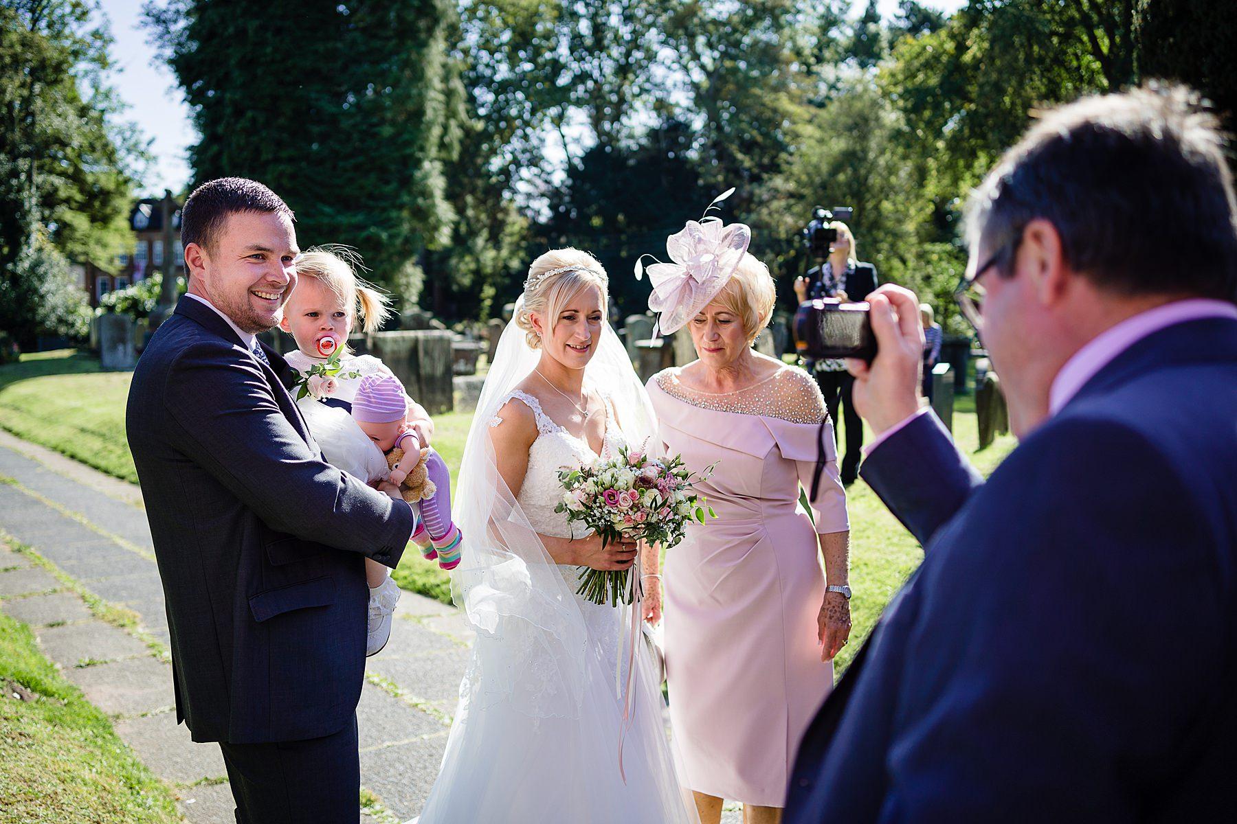 guests congratulate couple