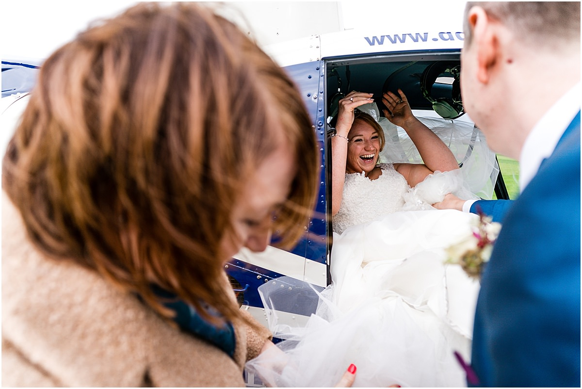 bride getting into helecopter