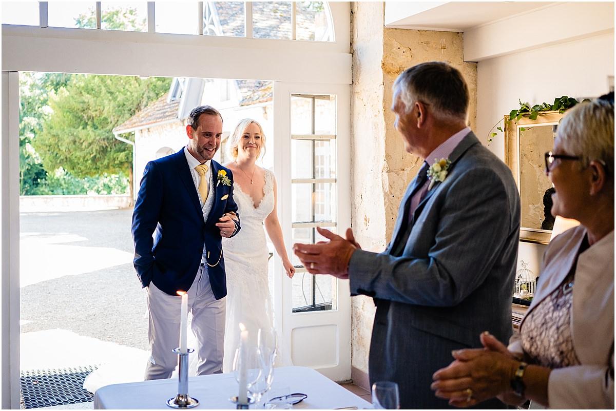 bride and groom enter room
