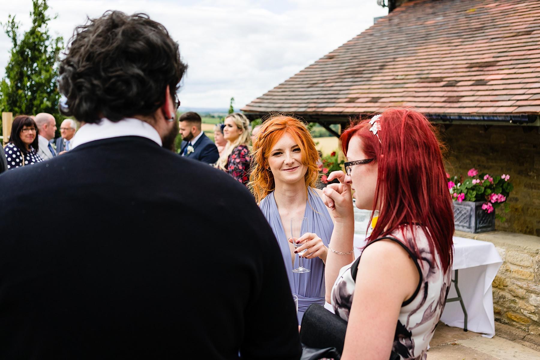 natural wedidng photos of guests mingling