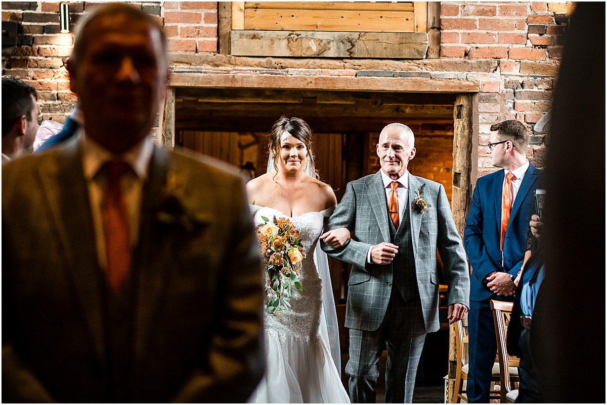 bride and dad walking down isle