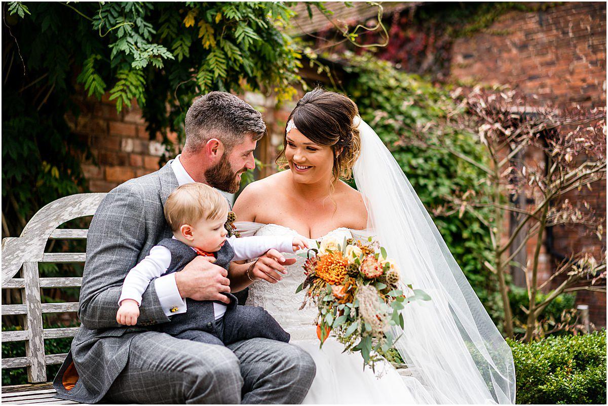 natural wedding photos of couple and son