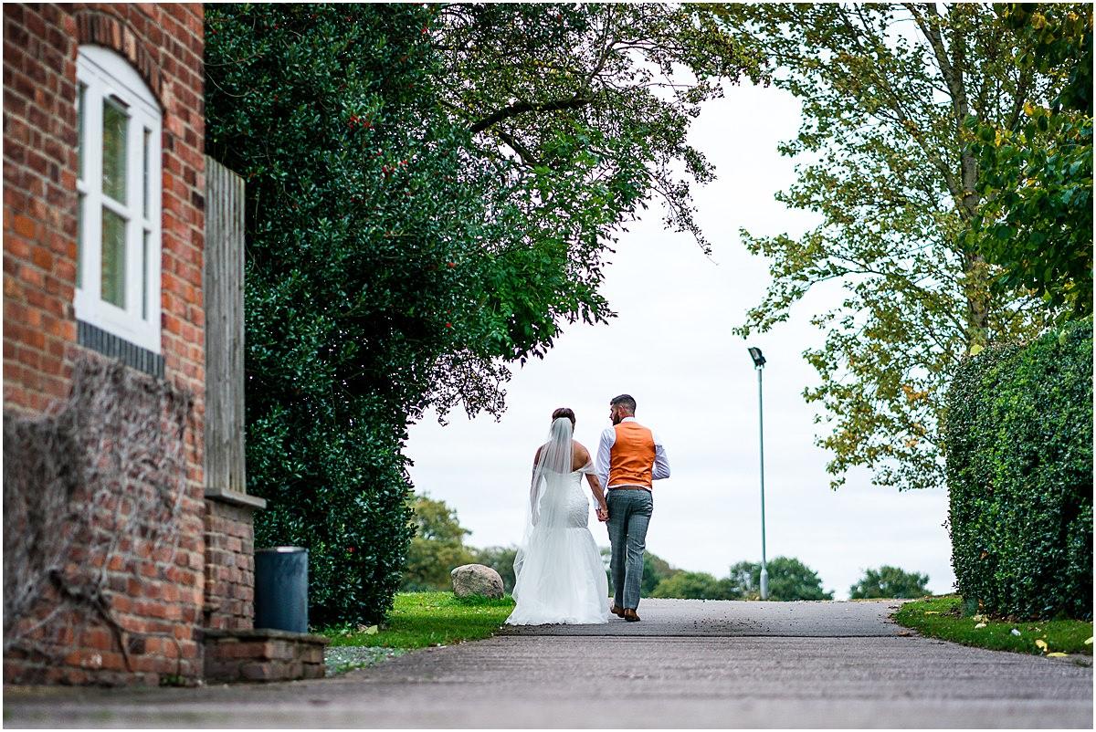 bride and groom talk a walk in private