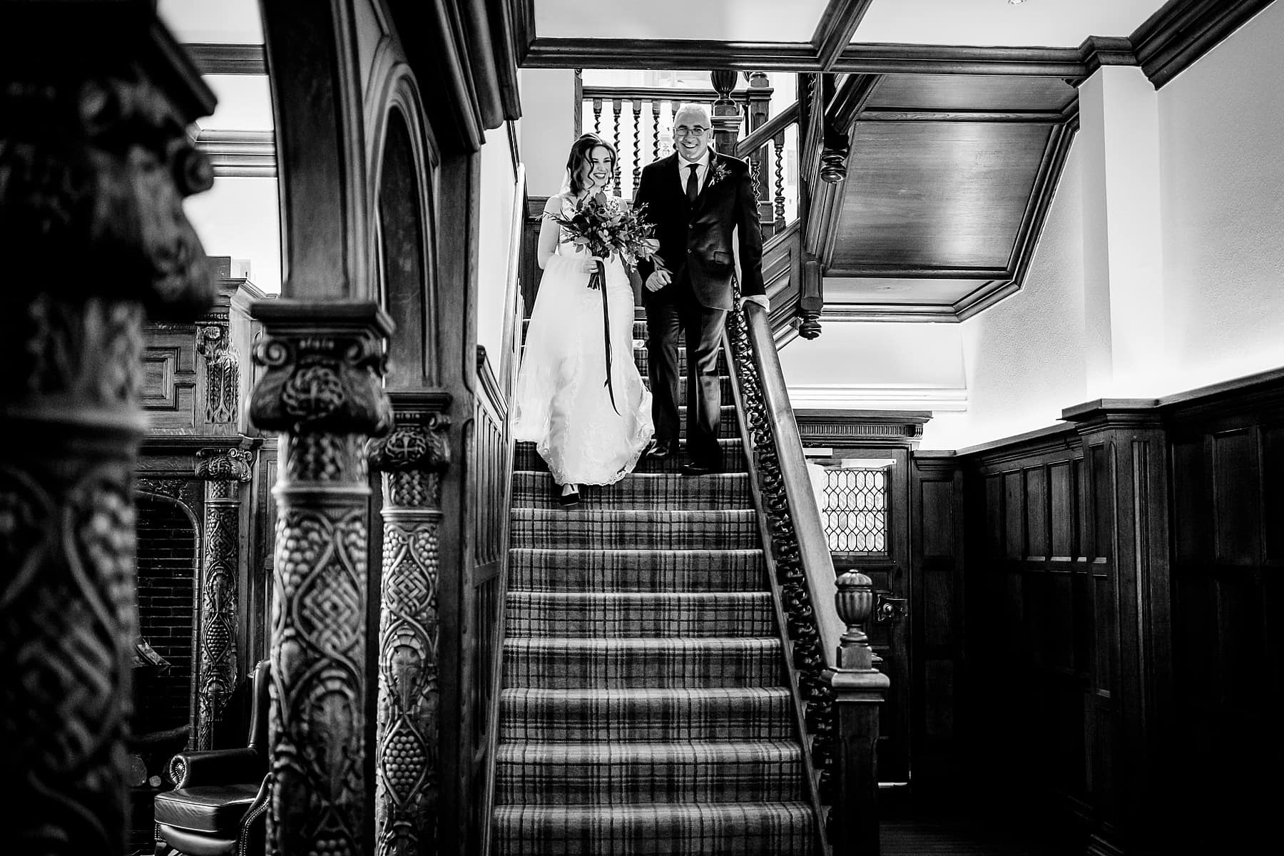 dad and daughter walking down aisle