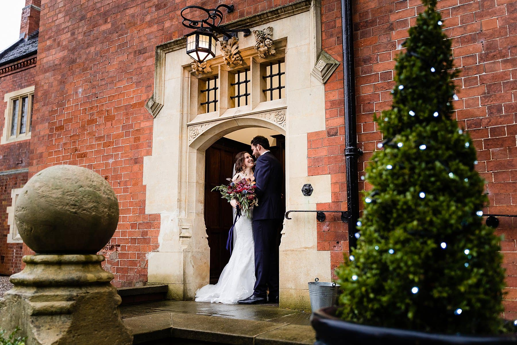 bride and groom photos in the rain at pendrell hall