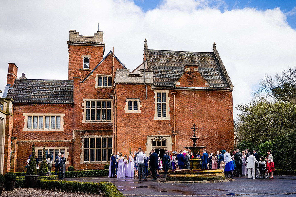 natural wedding photos of guests mingling outside pendrell hall