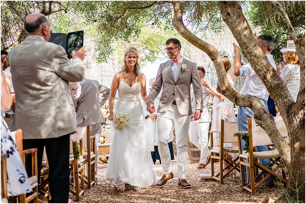 bride and groom recessional at wedding ceremony at Binifadet vineyard
