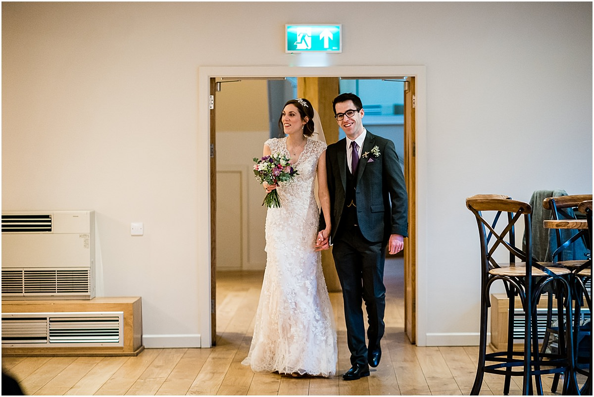 bride and groom enter ceremony room