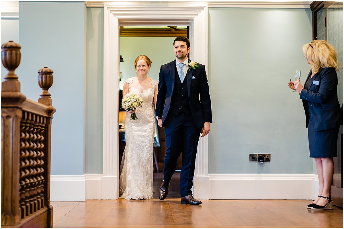 bride and groom enter dining room