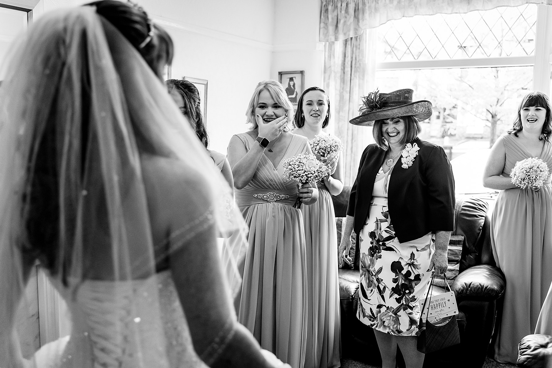 bridesmaids see bride in dress for the first time