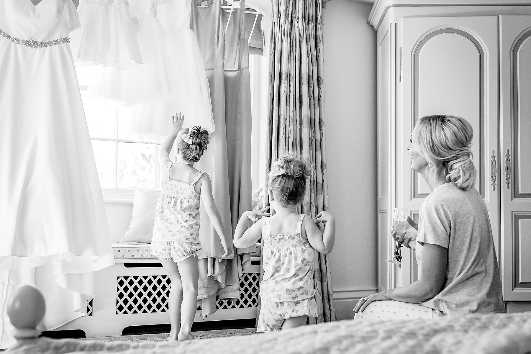 flowergirls looking at the dress