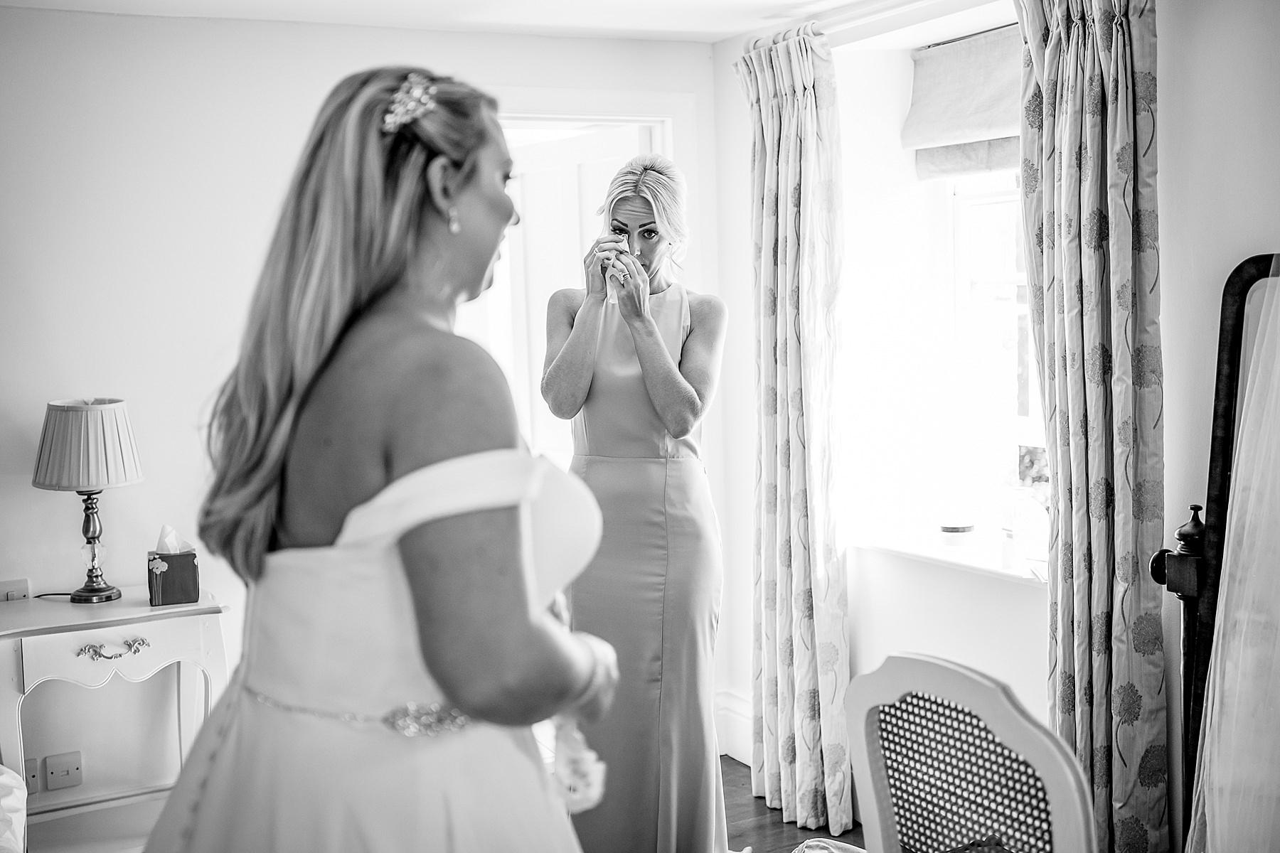 bridesmaid emotional at bride
