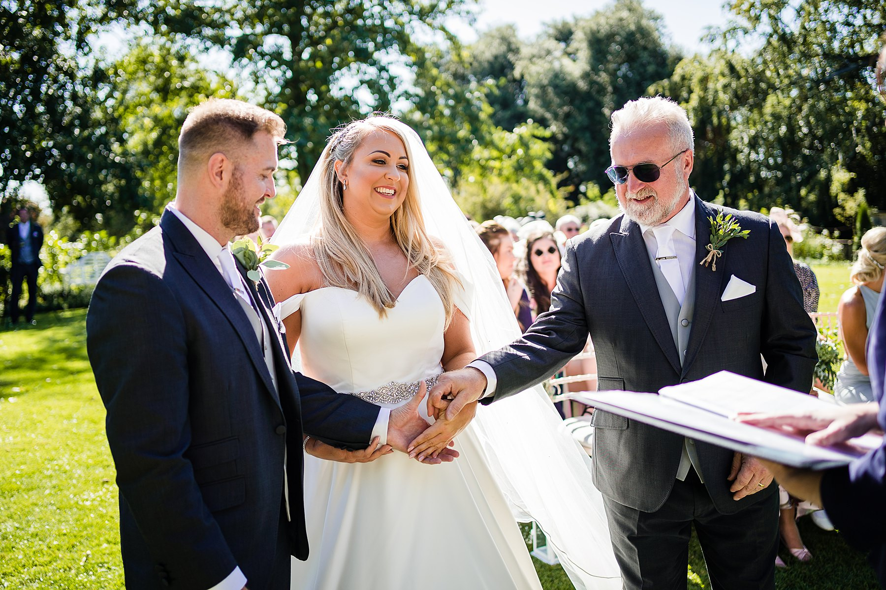 dad hands bride over to groom