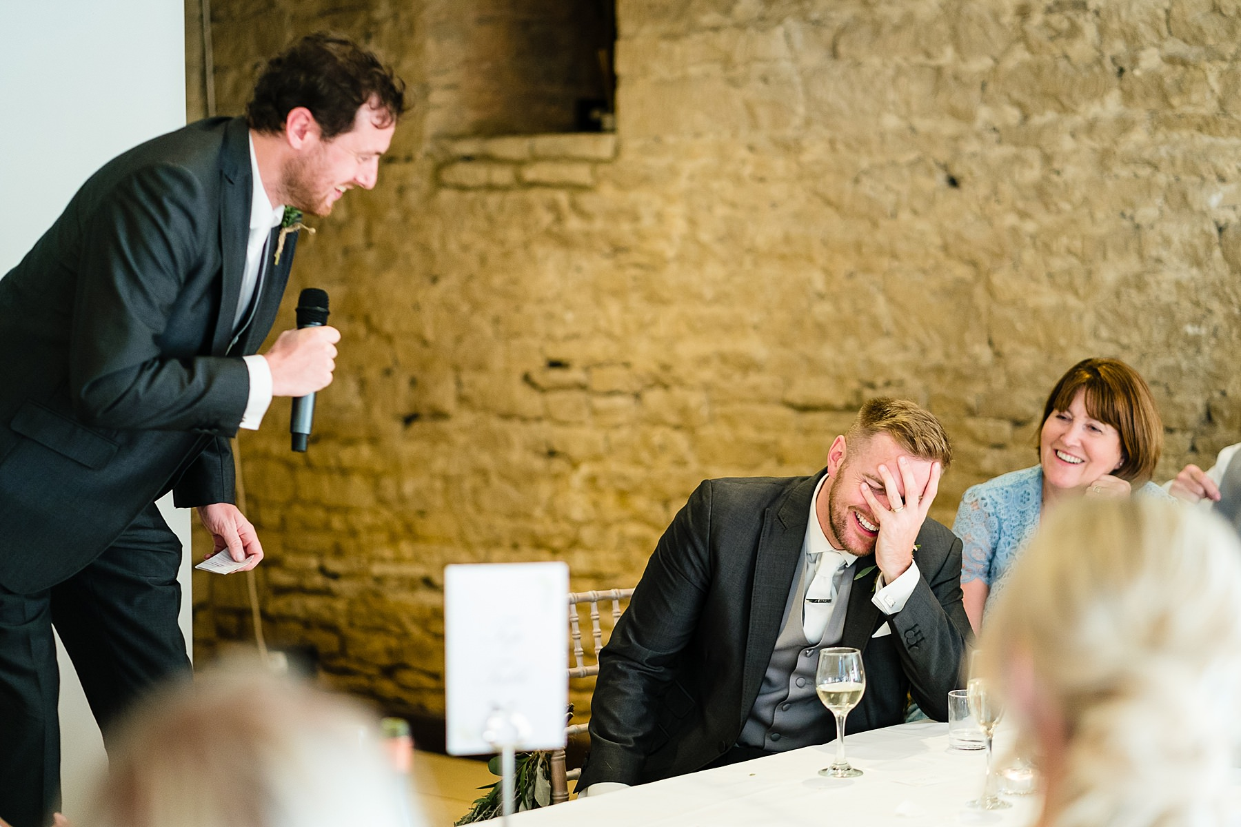 groom looks embarassed at speech
