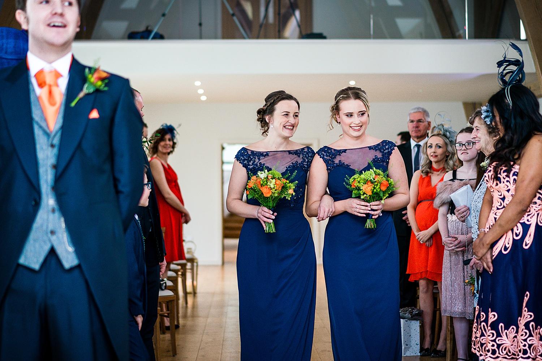 bridesmaids walking down isle