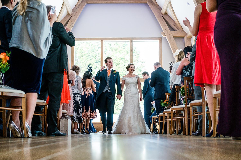 bride and groom walking down osle
