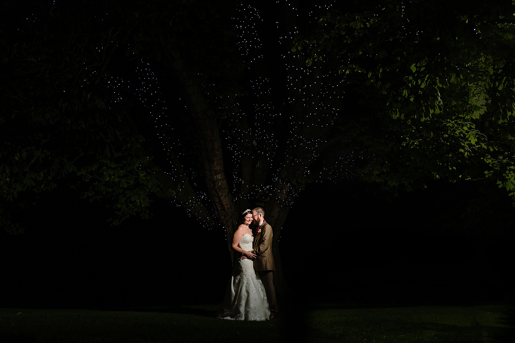 wedding photos with the tree at the moat house