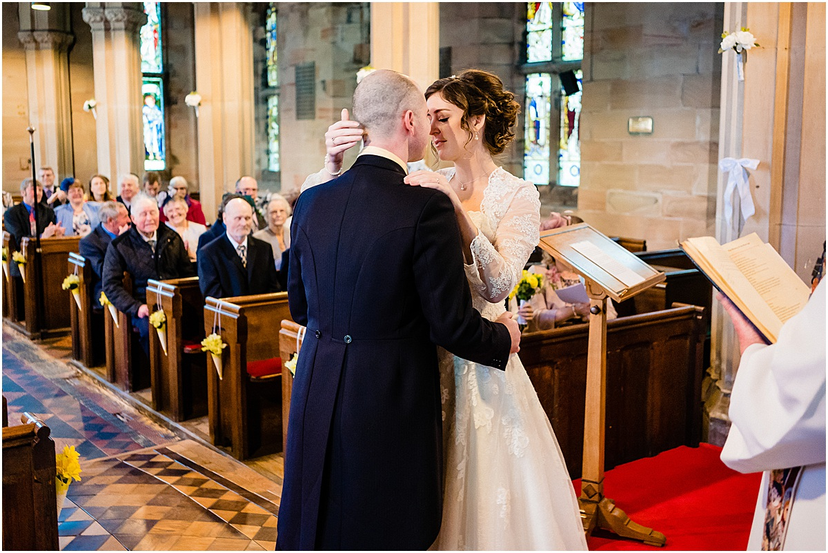 wedding ceremony at all saints church leigh
