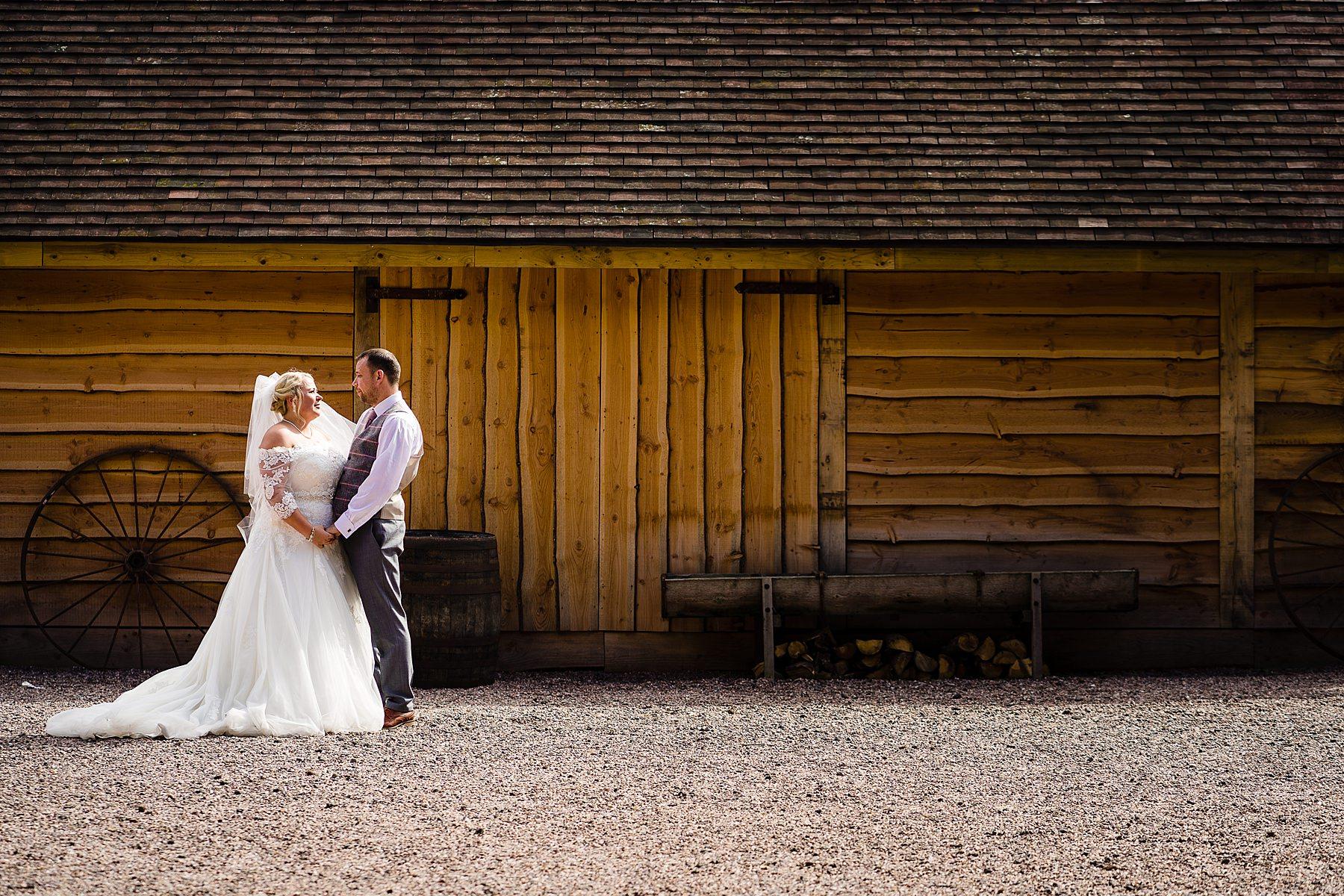bride and groom photos at bridal barn