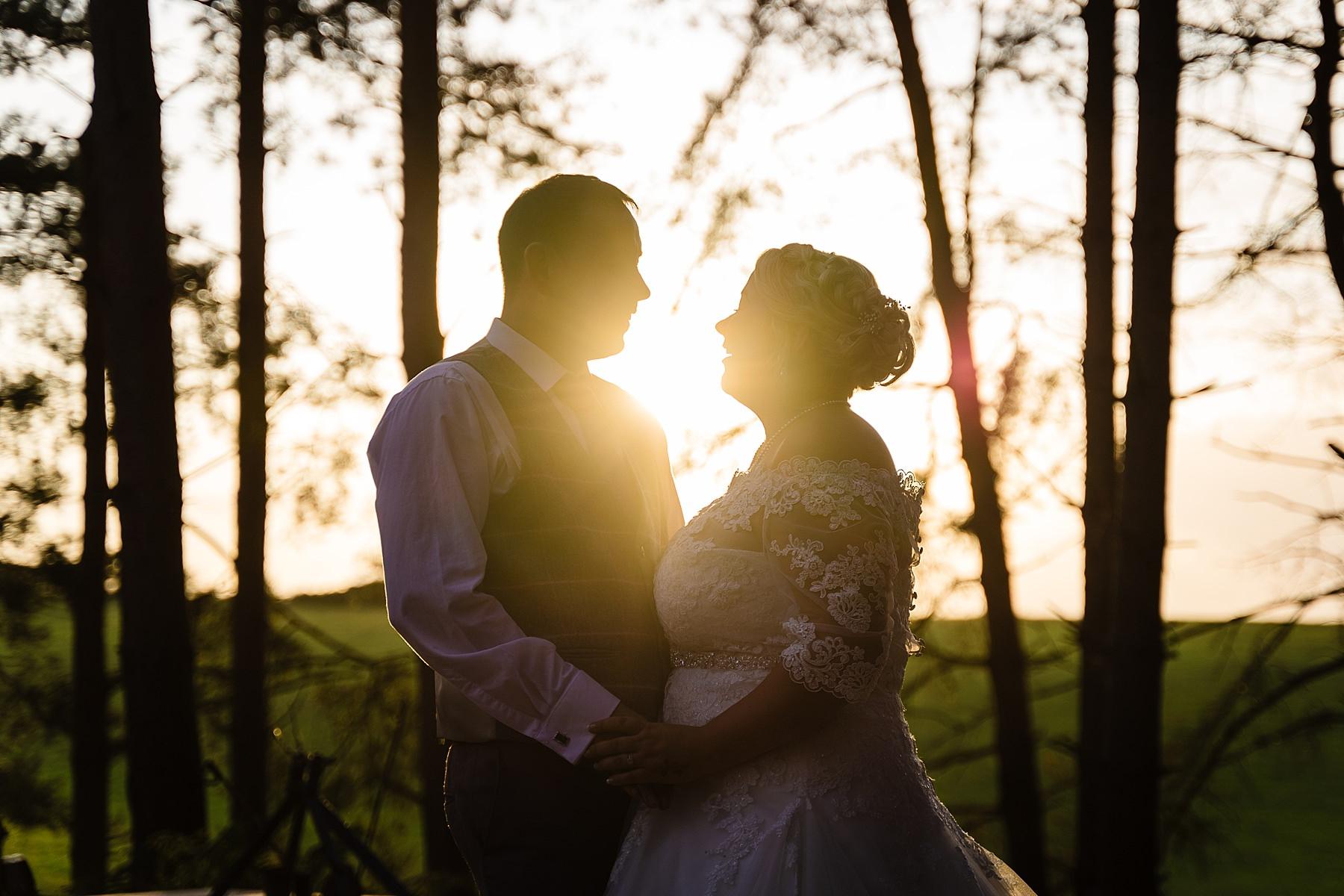 bride and groom evening photos at bridal barn