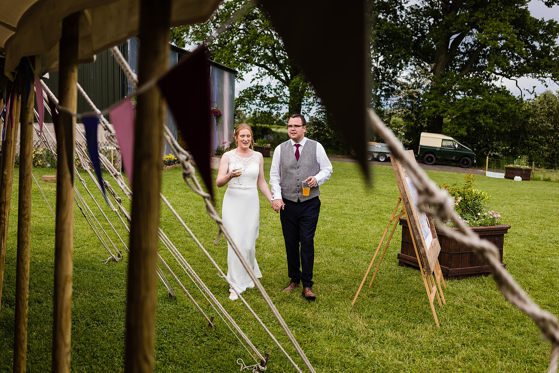 bride and groom head to marquee