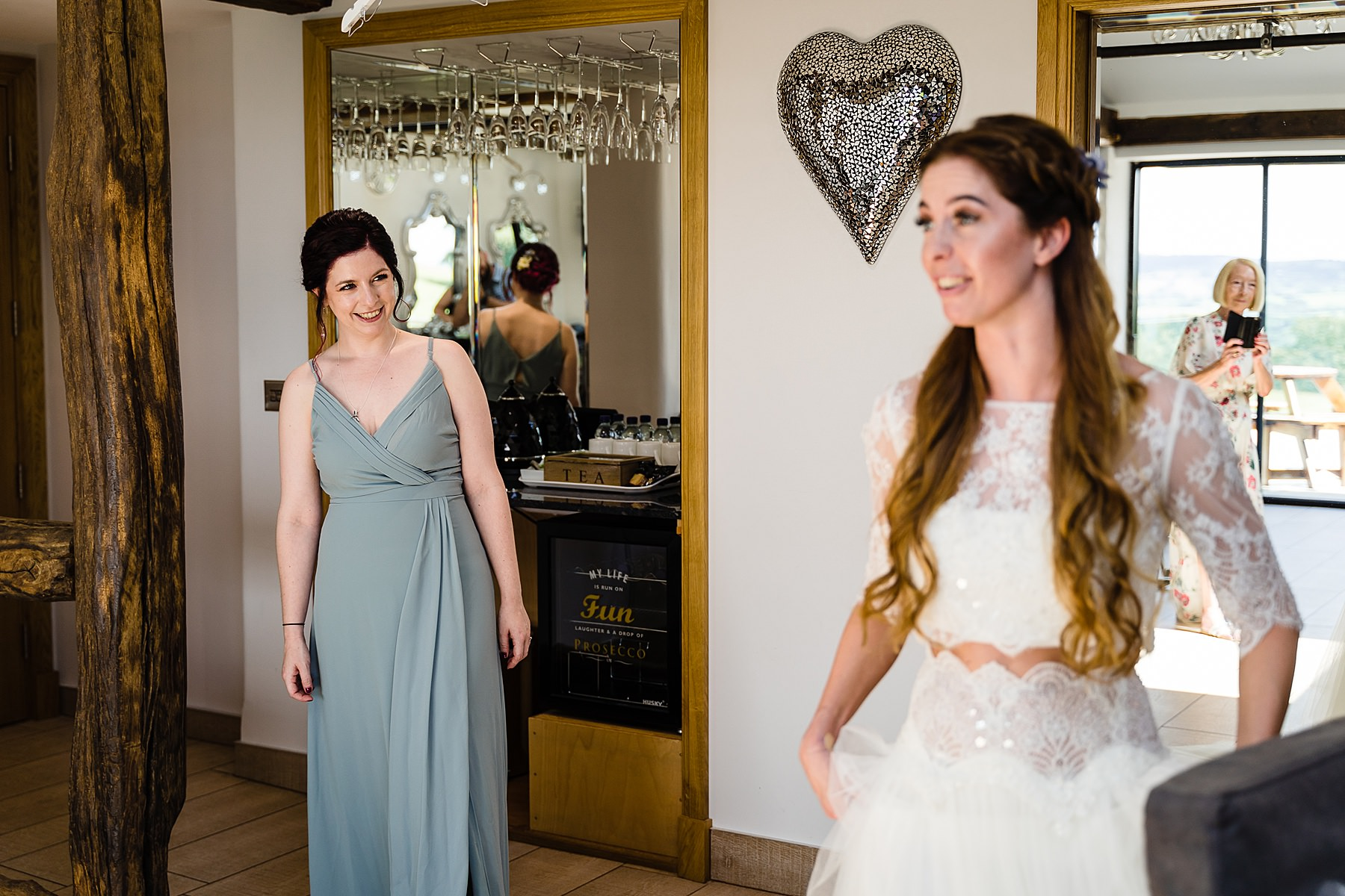 bridesmaid admiring dress