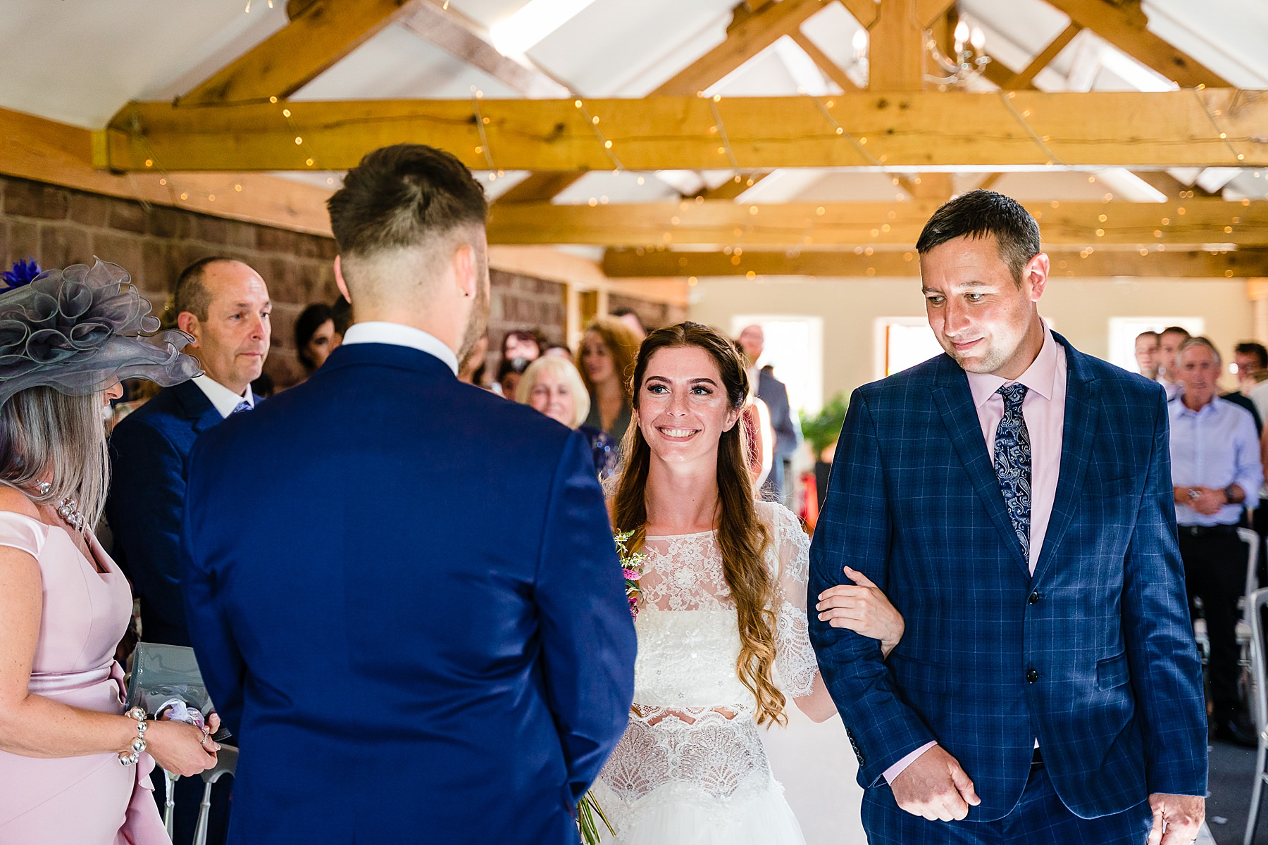 bride walks down the aisle with dad