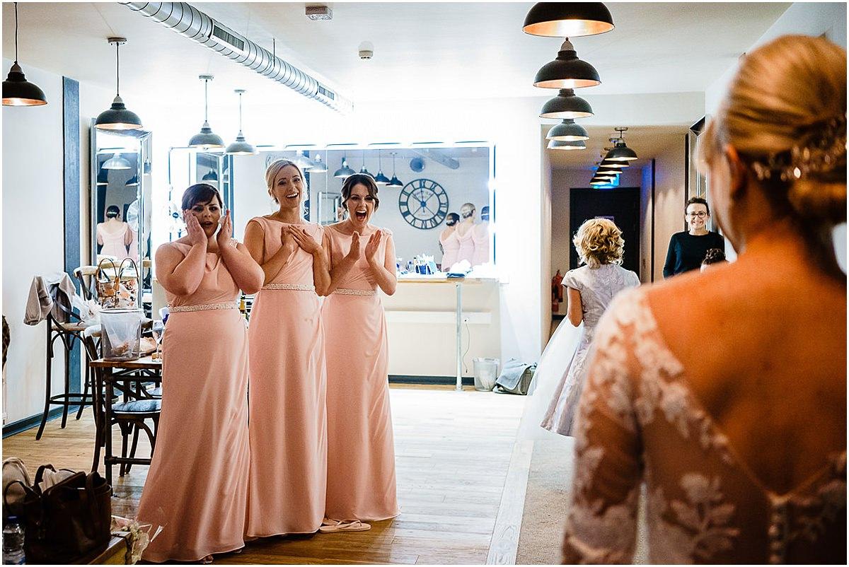 bridesmaids see bride