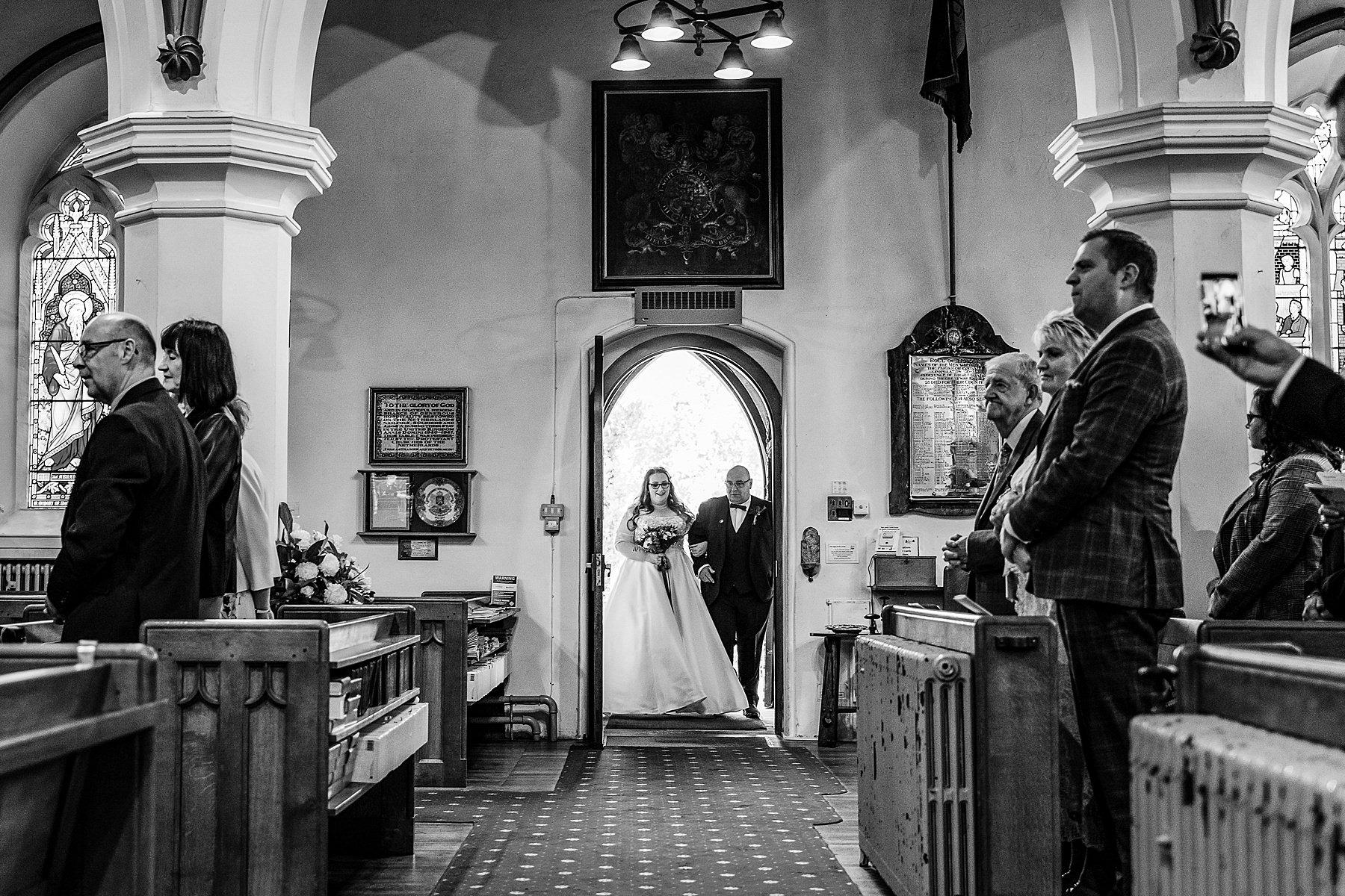 bride and dad enter church
