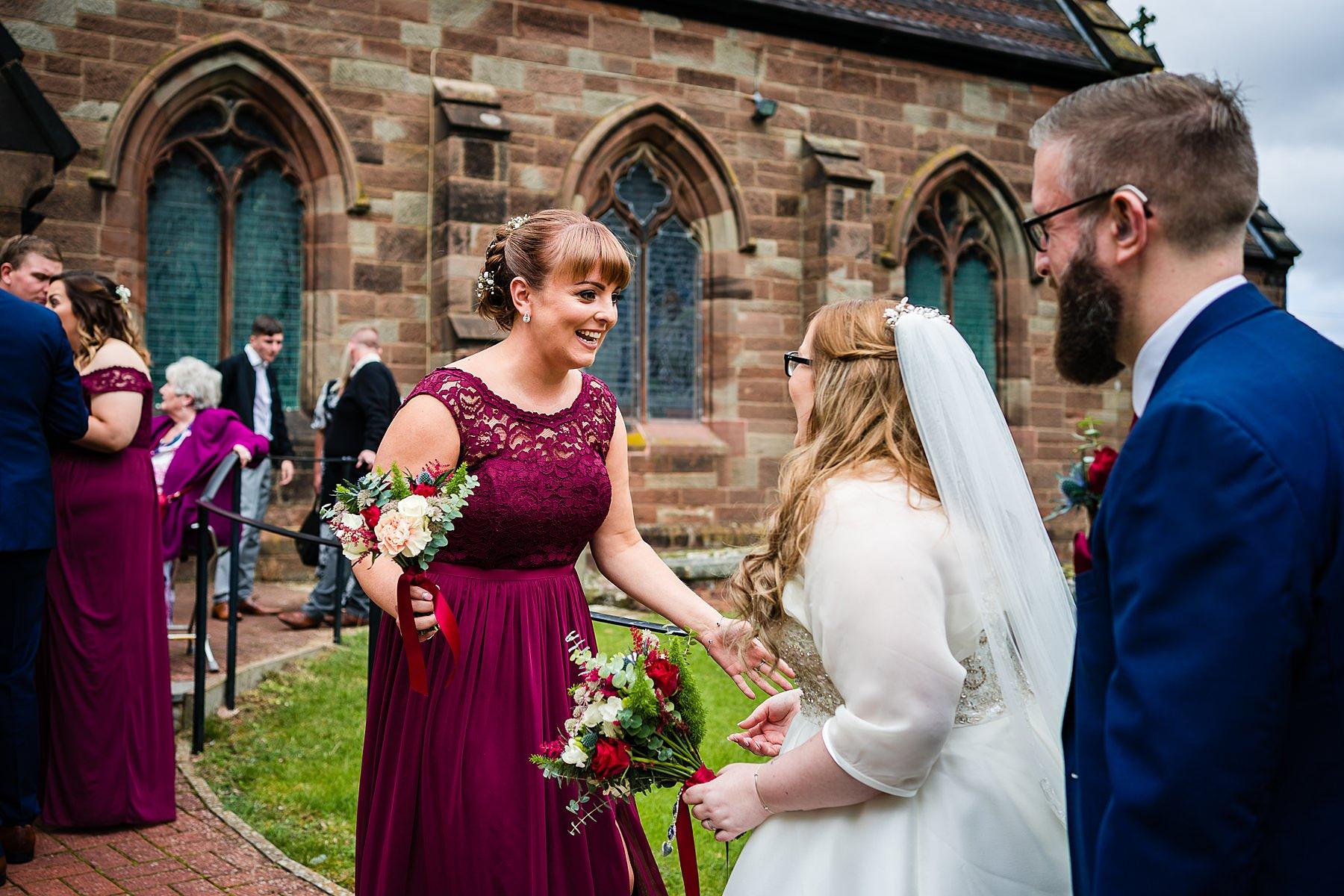 bride and groom greet guests
