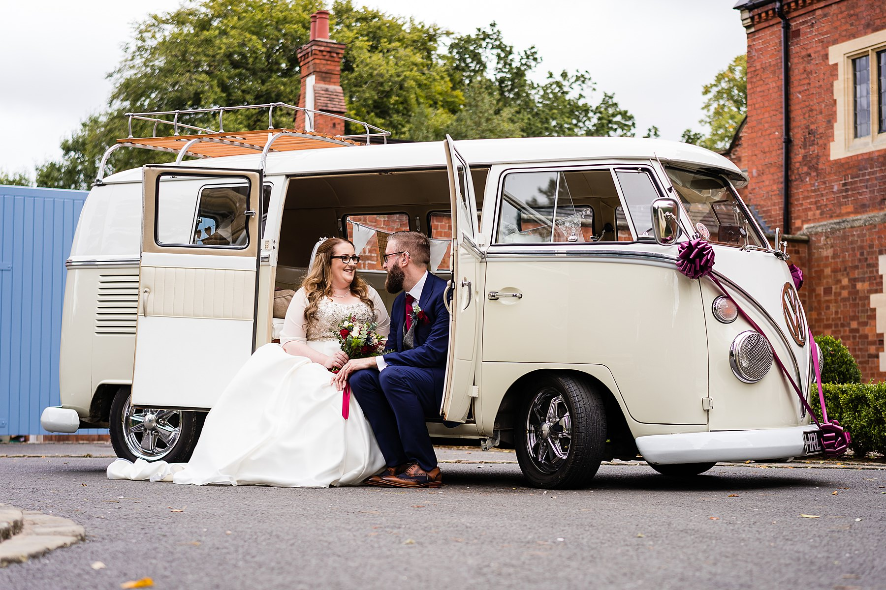 bride and groom portrait with campervan