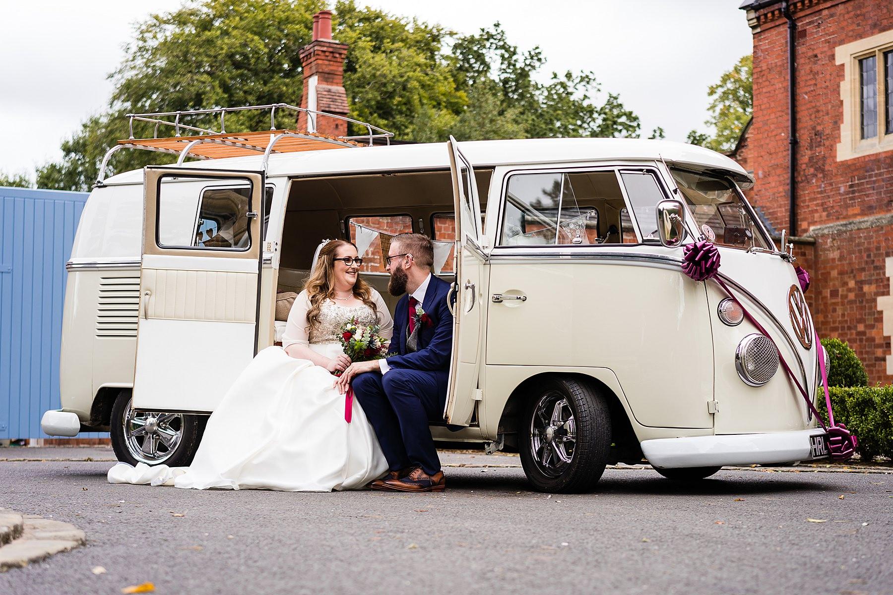bride and groom portrait with campervan