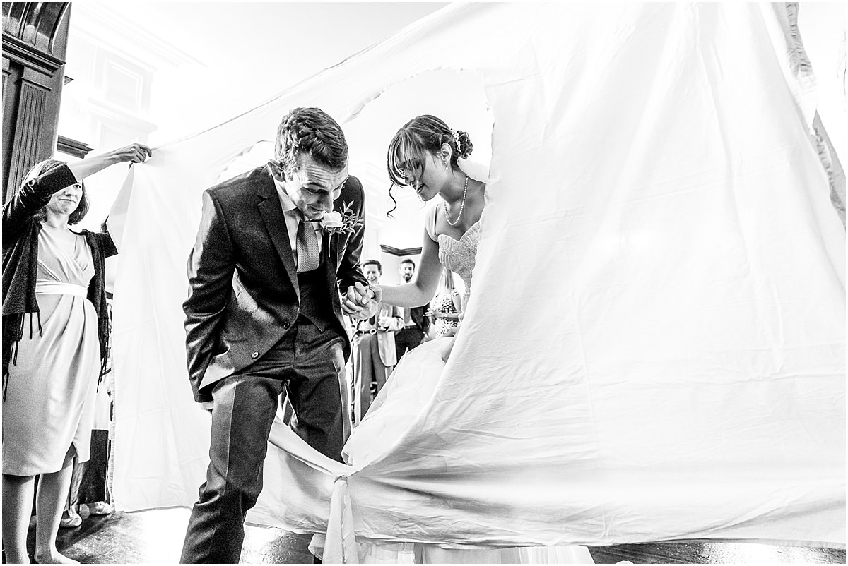 cutting the bed sheet at a wedding
