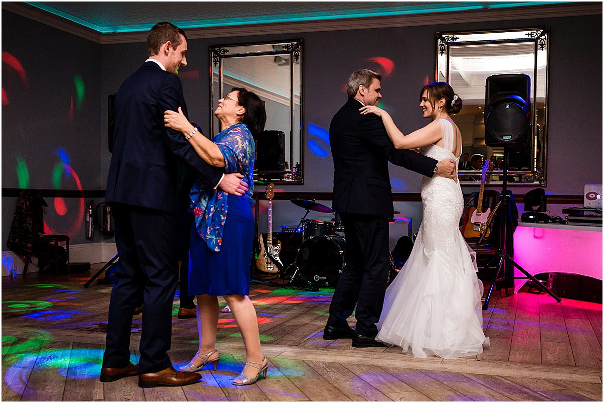 couple and their parents dancing