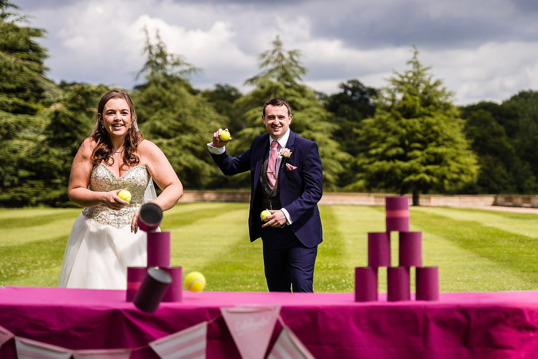 bride and groom playing lawn games
