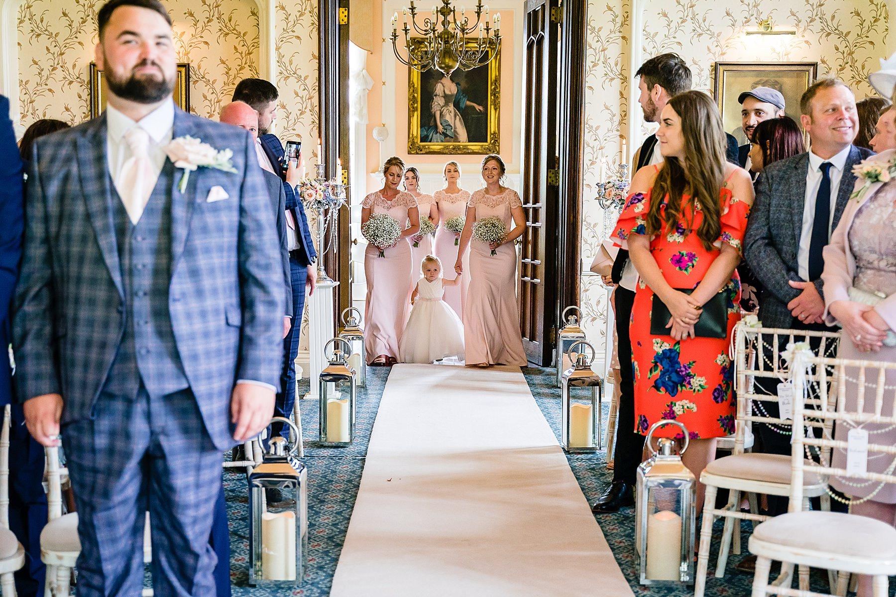bridesmaids enter ceremony room
