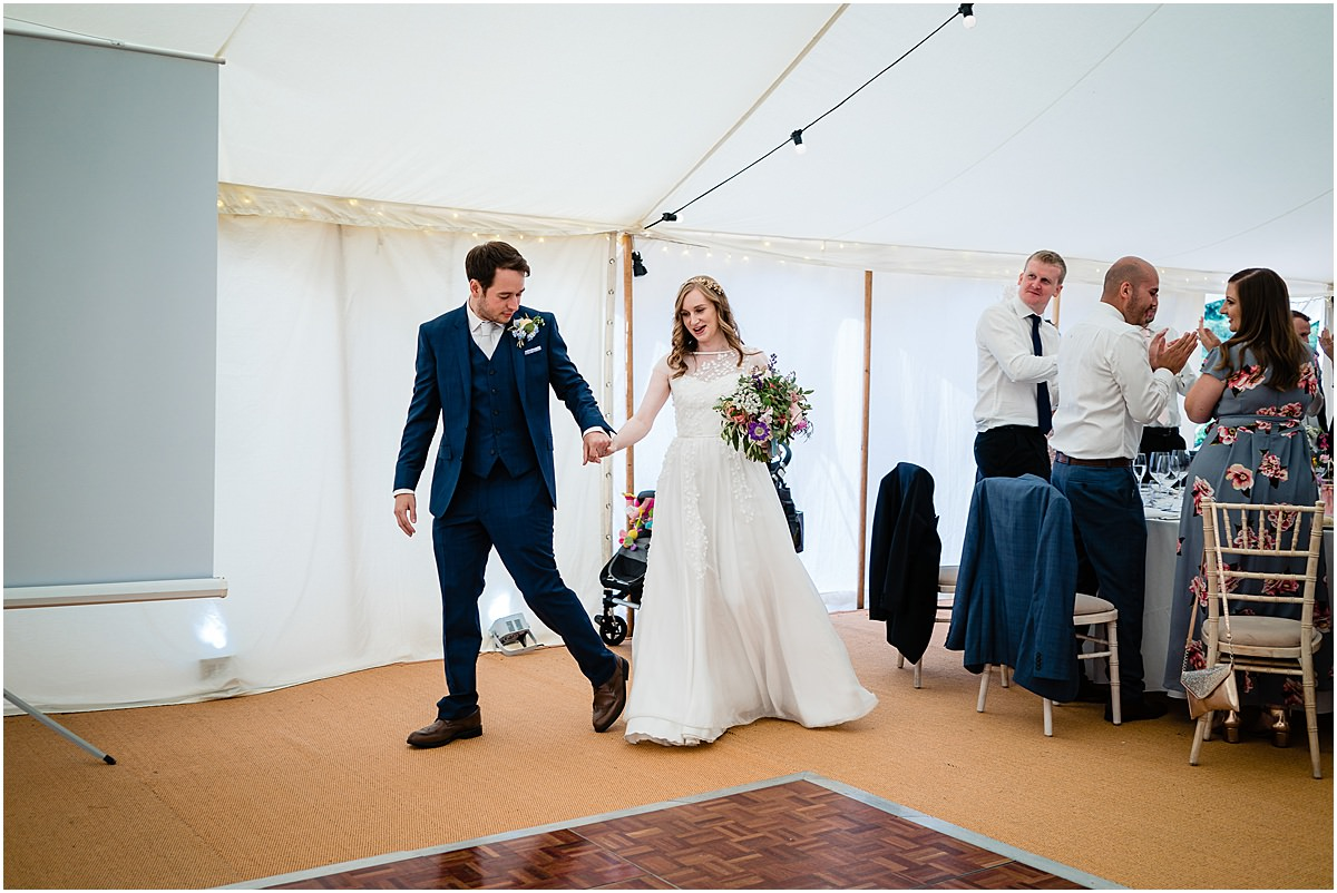 bride and groom enter room