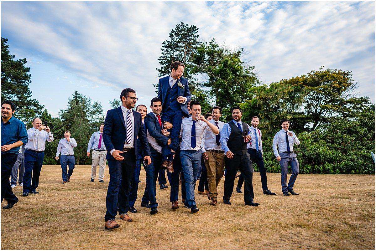 groomsmen horsing about