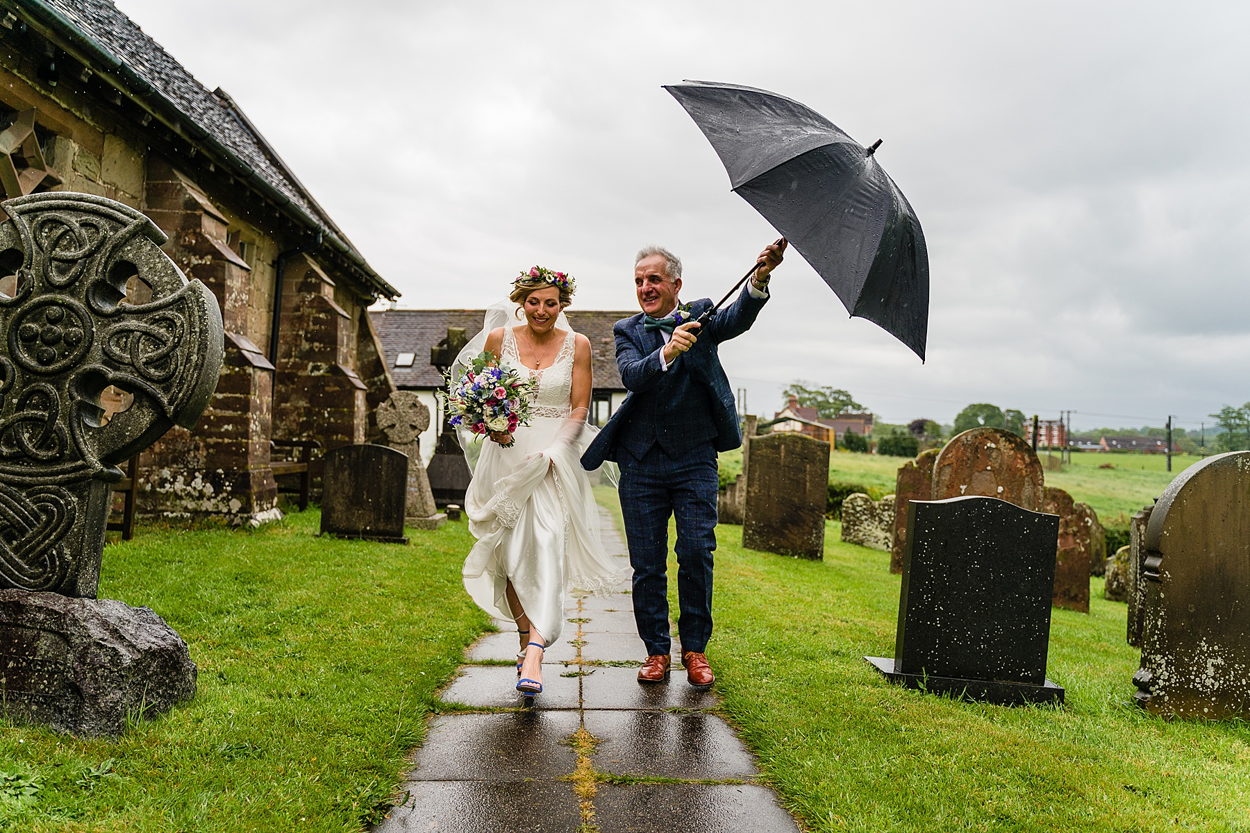 bride and dad on way to church in rain
