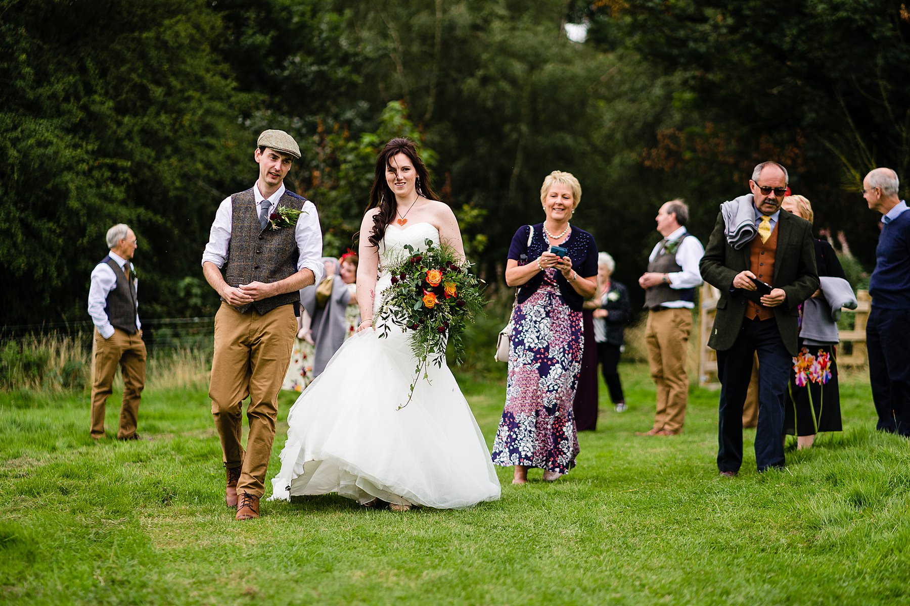 wedding guests walking to drinks reception together