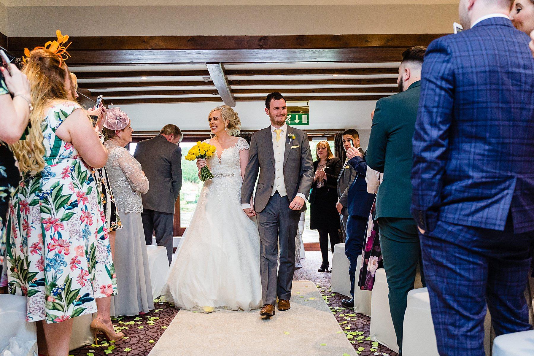 bride and groom leave